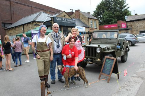 VJ Day celebrations picturing restored jeep and Cllr John Housley