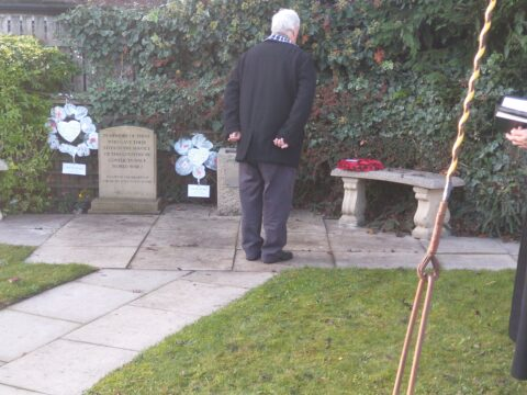 Chairman John Housley laying the wreath of Poppies